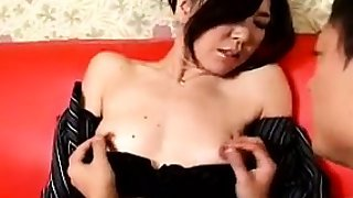 Pretty Oriental babe with a lovely ass is made to cum with