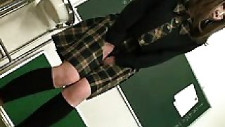 Slender Asian schoolgirl with sexy legs takes a piss in the