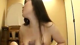 Buxom Asian lady uses her skills and attributes to please a