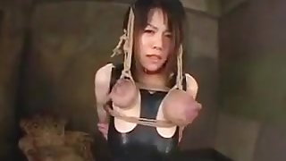 Flogging busty Asian