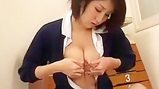 Big breasted Japanese nympho milks her hard nipples and suc