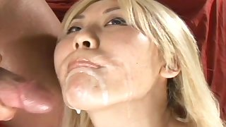 Pretty blonde is getting sperm in her mouth
