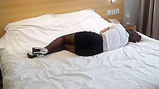 Beautiful chinese stocking girl in hotel room