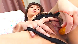Asian model Miri Sugihara plays with nice toys