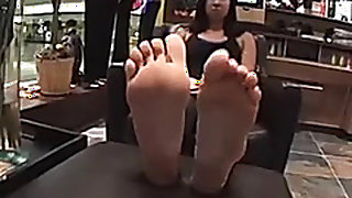 Mean Asian girlfriend teases me with her big stinky soles