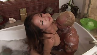 Soapy massage with a busty Asian