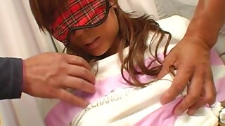 Japanese doll stimulated by two guys