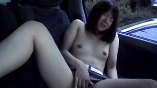 Hairy japanese finger fucking in the car