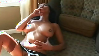 Busty asian smokes while posing