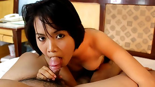 Innocent Asian babe rides on the long dick