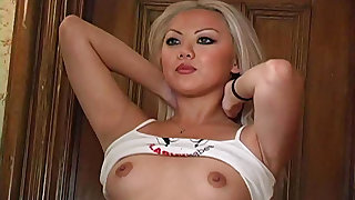 Blonde Asian teases her sexy tits