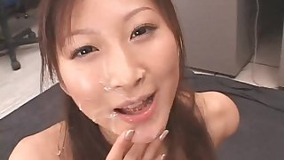 Japanese beauty is rubbing her hairy snatch