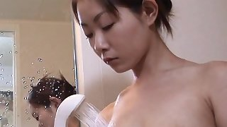 Asian chick being fucked with vegetables