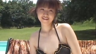 Slutty Asian babe is sucking that hairy pole
