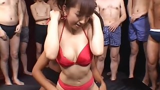 Cute Japanese girl sucks a lot of cocks and swallows cum