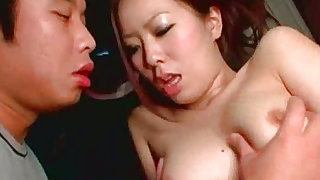 Redhead asian  with nice ass is sucking cock in the car