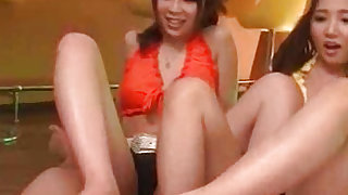 Elegant and sexy japanese chicks are doing footjob to their bf