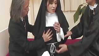 Nun Hitomi Kanou shares her hot cunt with two horny priests