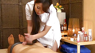 Sexy Japanese gives warm handjob and loves stroking cock with lust